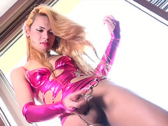 Shemale in a sexy costume loves stroking her big cock