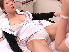 Two Asian nurses kiss, get naked and eat those wet pussies