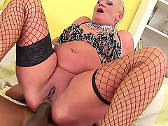 Horny mature chick gladly takes the black cock into her butthole