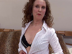 Curly-haired granny with a dirty mind using the realistic dildo