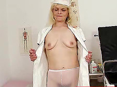 Naughty granny nurse dildoing her hairy pussy in the hospital