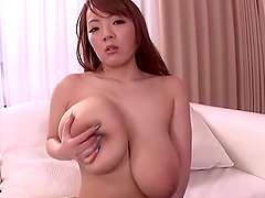 Japanese milf plays with her gigantic natural boobs and sucks a cock