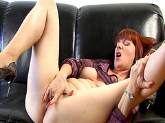 Curvy cougar with huge natural tits playing with her shaved pussy