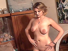 Kinky cougar with big natural tits playing with her shaved pussy