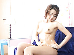 Stacked Asian hussy tickles her puffy pussy with her love egg