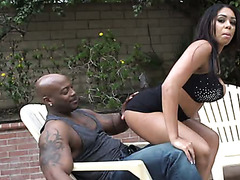 Big breasted Latin sex doll sucks thick black penis of her kinky guy greedily