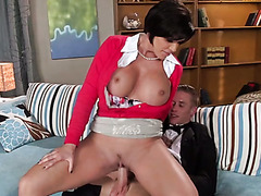 Busty brunette milf rides young dude reverse and gives him titjob