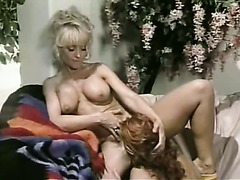 Young Nina Hartley making love in retro lesbian sex clip