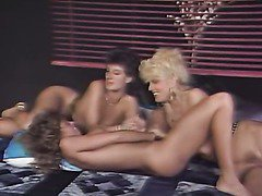 Lovely retro lesbians fondle each other and lick smooth feet