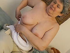 Lusty BBW granny with huge tits masturbates with pink vibrator