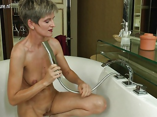 Mature amateur mom having bath time