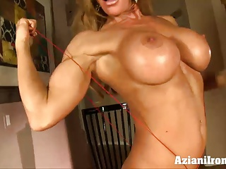 Fitness MILF stuffs with her wet pussy with a fat dildo