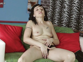 Mature mom-next-door and her red dildo