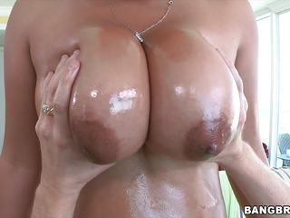Big breasted Asian babe gets oiled up and fucked