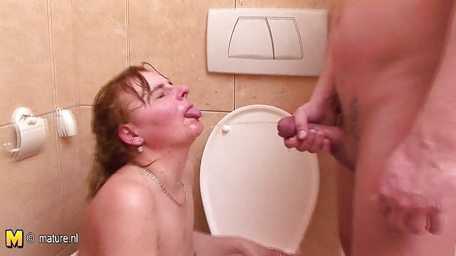 While taking a piss mom licks ass and sucks cock