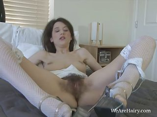 Tiffanny pleasures her juicy hairy pussy