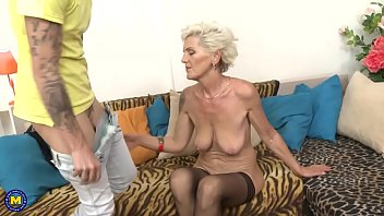 Tattooed busty granny gets fucked by a young guy - 6 min HD
