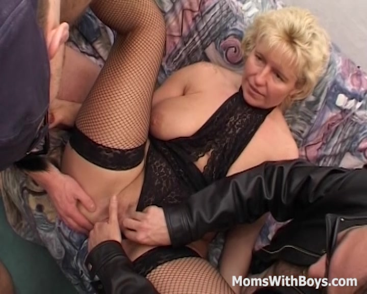 Horny blonde in sexy lingerie and fisnet stockings lets two boys play