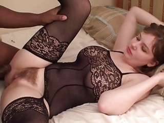 Busty brunette wears sexy lingerie for the interracial fucking session