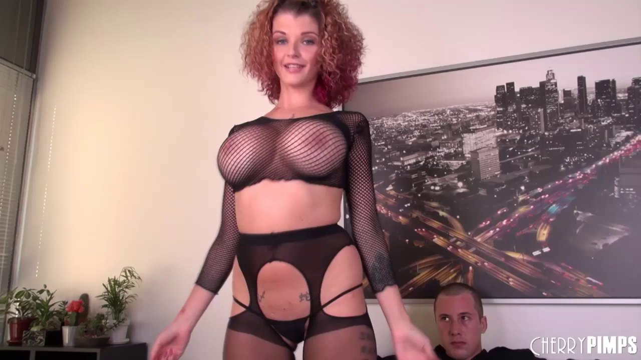Redhead in nylons and big tits gives a footjob before getting fucked
