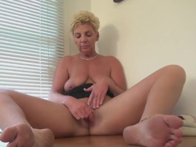 Dutch mature amatory housewife masturbating