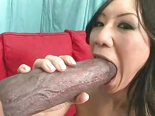 Petite asian brunette playing with large black meat popsicle